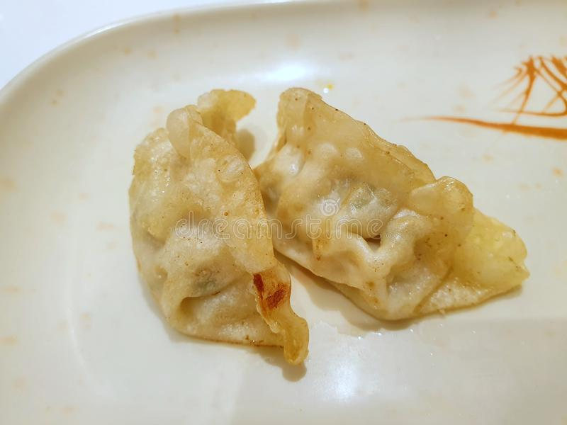 Top view of fried pot stickers or Gyoza on white in Restaurant royalty free stock photography