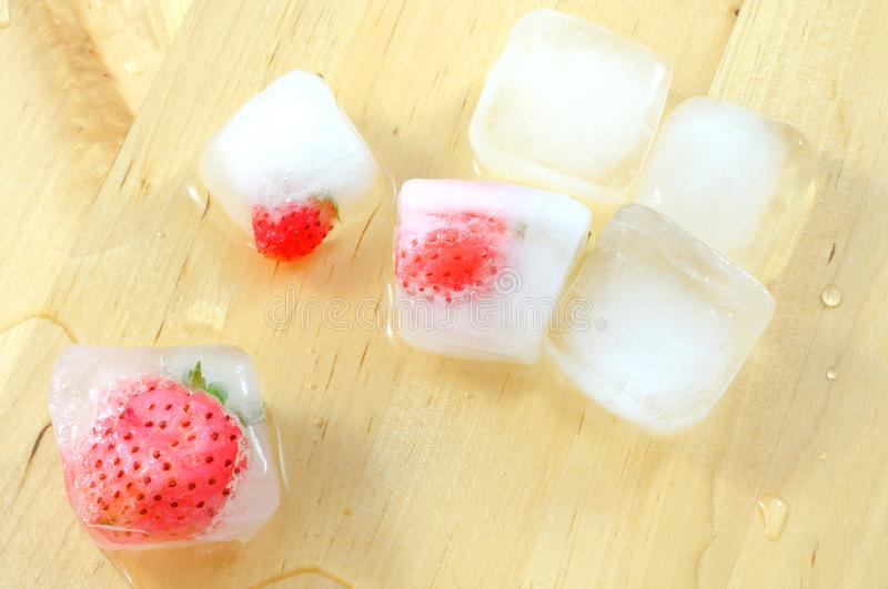 Top view of frozen strawberries in ice cubes royalty free stock photo