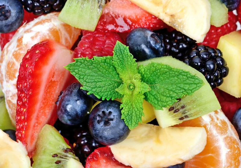 Top view of a fruit salad with strawberries, oranges, kiwi, blueberries and bananas. Close up of top view of a fruit salad with strawberries, oranges, kiwi royalty free stock photography