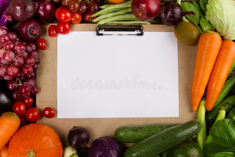 Top view of Fruits and Vegetable border with writing pad and paper for writing text stock images