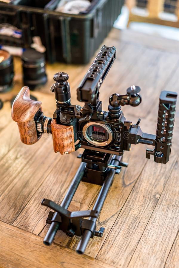 Top view of Full Equipment Videography set for Mirrorless small camera. Full Equipment Videography set for Mirrorless small camera for work. Handles, Wooden grip royalty free stock photos