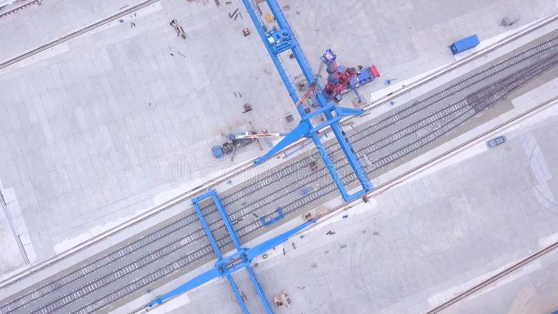 Top view of the gantry crane on the transport site. Clip. Various brands and colours of Shipping containers stacked by. Transtainers Mobile gantry cranes off of stock images