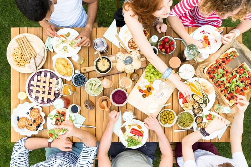 Top view on garden table with food during friend`s party royalty free stock photography