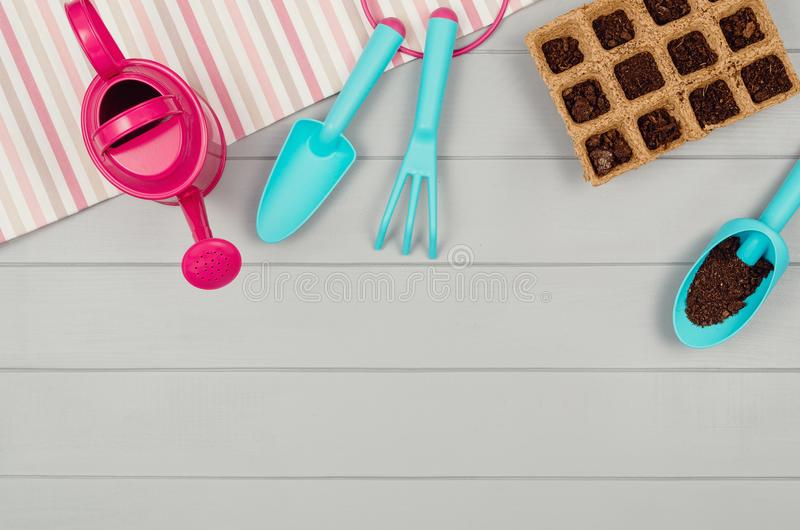 Gardening tools on gray wooden table background top view stock photos