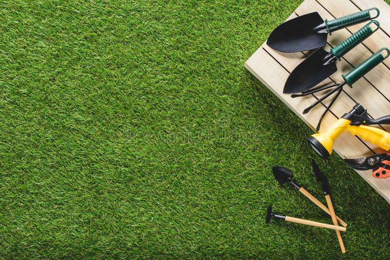 Top view of gardening tools and equipment. On grass stock images