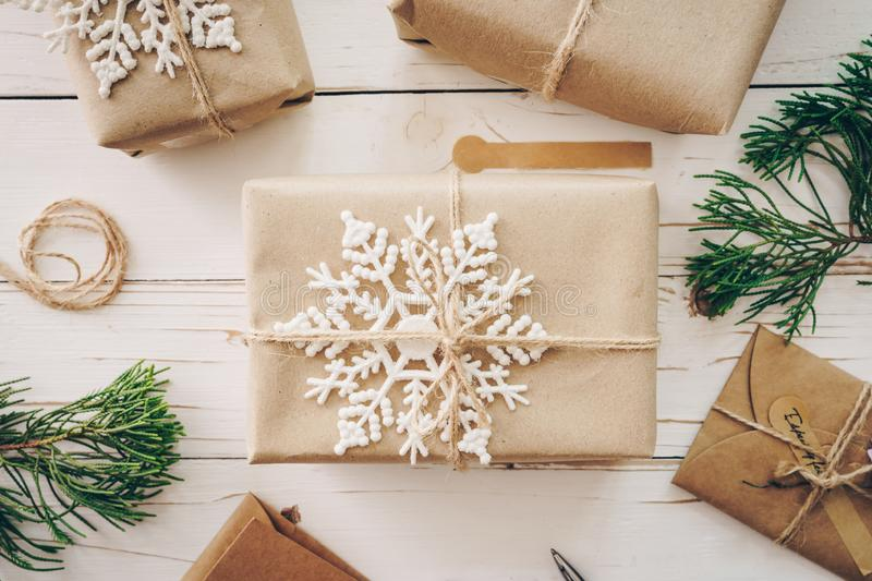 Top view of gift box and christmas card on wooden table with xmas decoration royalty free stock photography