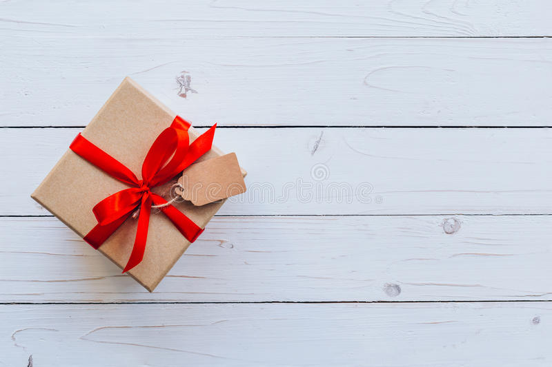 Top view gift box on wood table background with copy space royalty free stock images