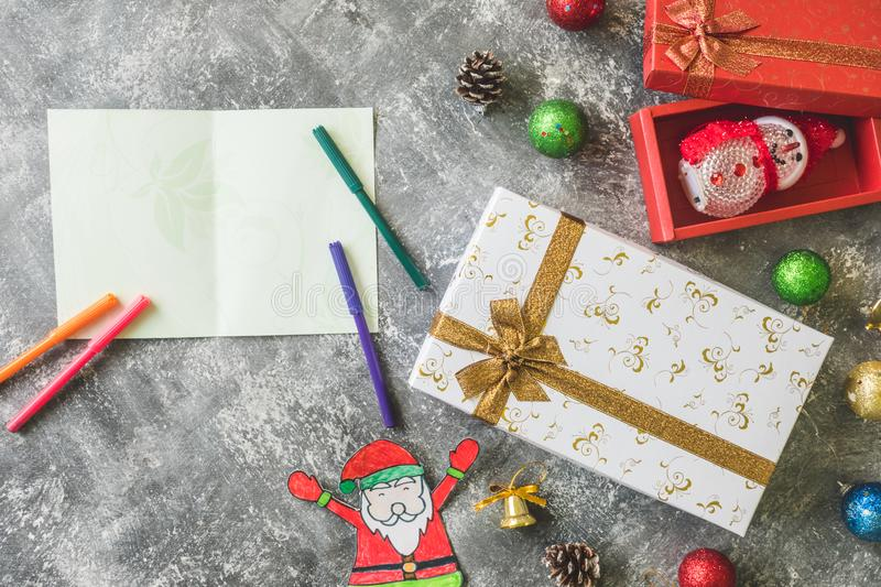 Top view of Gift boxes with Christmas decoration and card on gray grunge background. Seasonal, Festival and Holiday Concept stock images