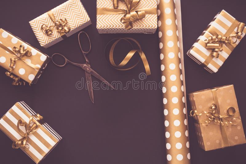 Top view of gift boxes in golden designs. Flat lay, copy space. A concept of Christmas, New Year, birthday celebration royalty free stock image