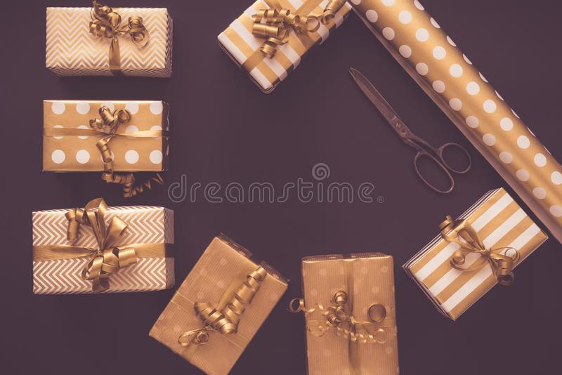 Top view of gift boxes in golden designs. Flat lay, copy space. A concept of Christmas, New Year, birthday celebration stock photography