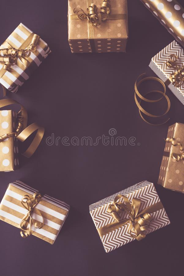 Top view of gift boxes in golden designs. Flat lay, copy space. A concept of Christmas, New Year, birthday celebration royalty free stock photos