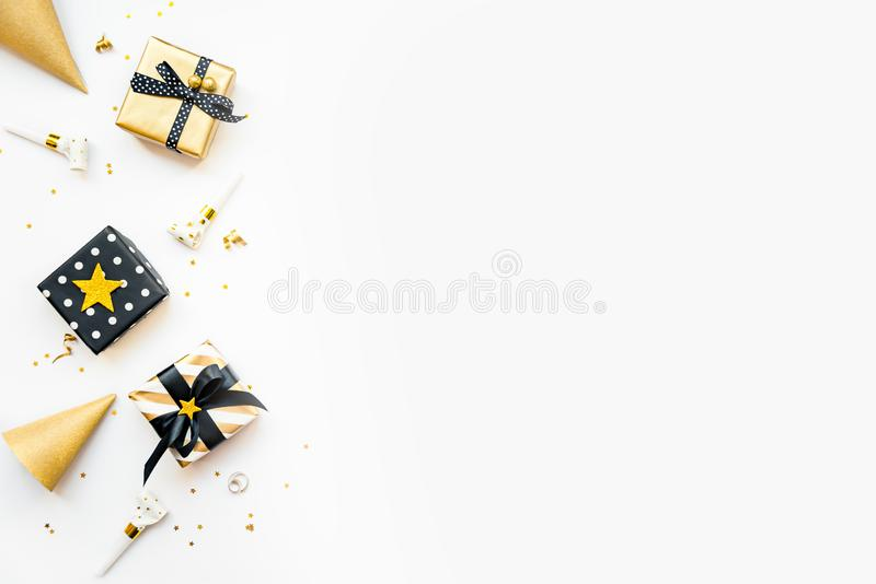 Top view of gift boxes and party accessories in various black, white and golden designs. Flat lay, copy space. A concept of stock photos