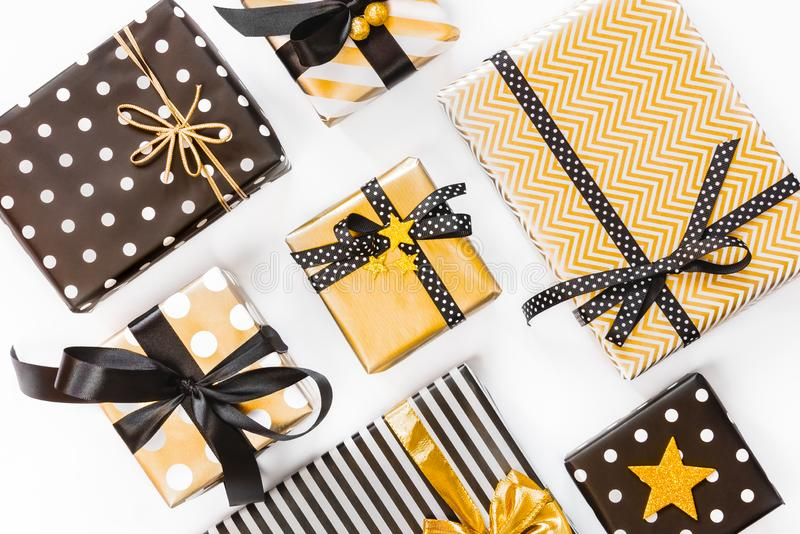 Top view of gift boxes in various black, white and golden designs. Flat lay. A concept of Christmas, New Year, birthday celebratio royalty free stock image