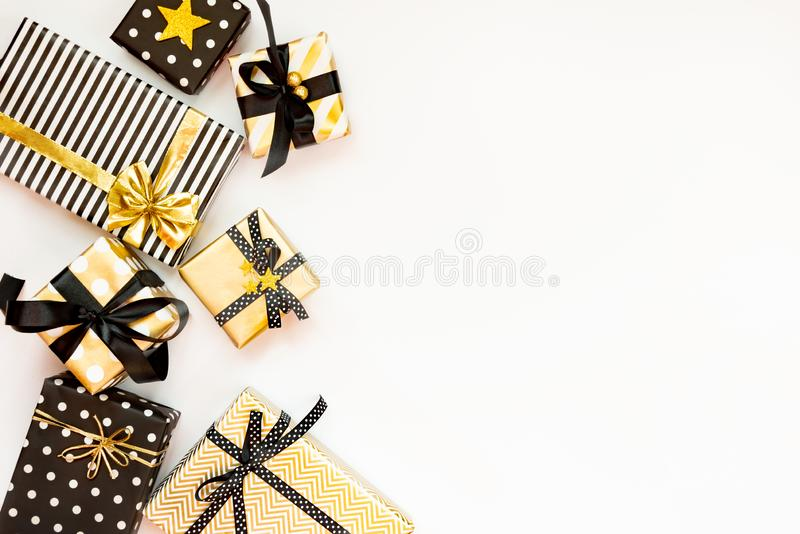 Top view of gift boxes in various black, white and golden designs. Flat lay, copy space. A concept of Christmas, New Year, birthda royalty free stock photography