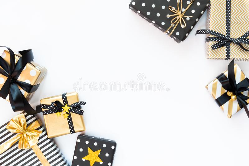 Top view of gift boxes in various black, white and golden designs. Flat lay, copy space. A concept of Christmas, New Year, birthda stock image