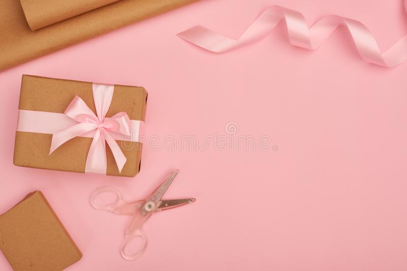 Gift wrapping set on pink flatlay stock image