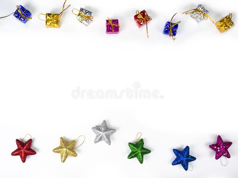 Top view of gifts and star border on white background. Christmas holiday concept.  stock photography