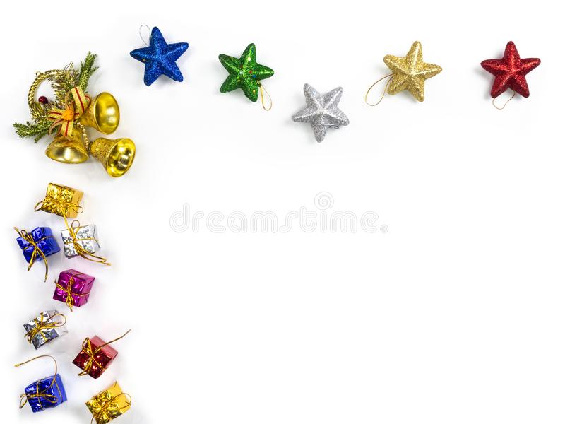 Top view of gifts and star border on white background. Christmas holiday concept royalty free stock image