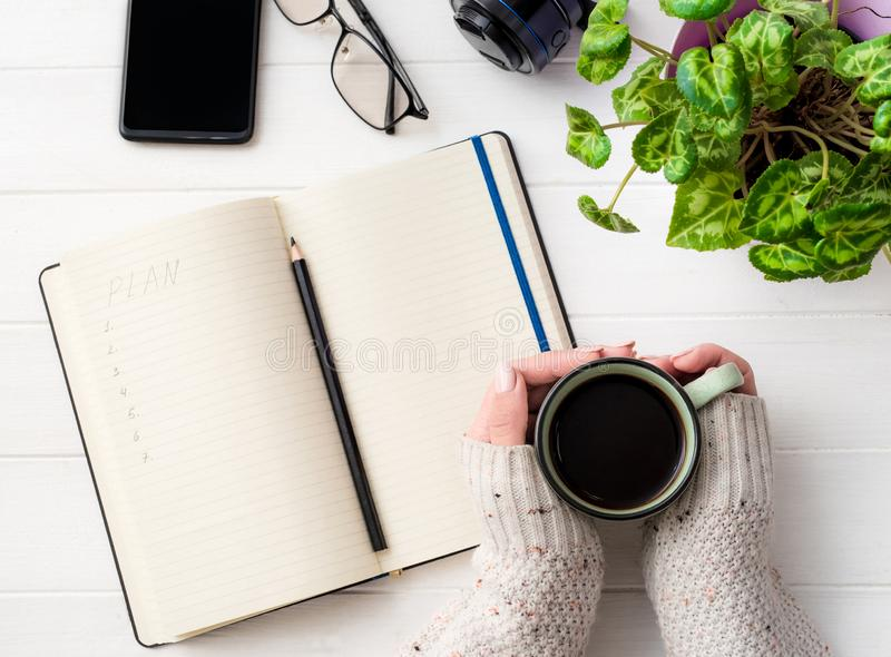Top view of girl holding coffee mug at working place royalty free stock photography