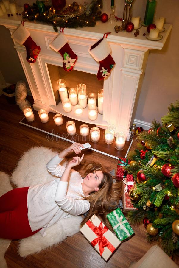 Top view of a girl lying under a christmas tree stock images