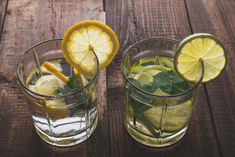 Top view of glass glasses with summer lemonade from water, lemon, mint and ice royalty free stock image