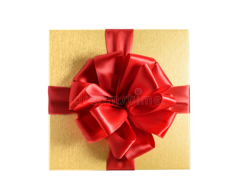 Top view golden gift box with red ribbon. Isolated on a white background royalty free stock photo
