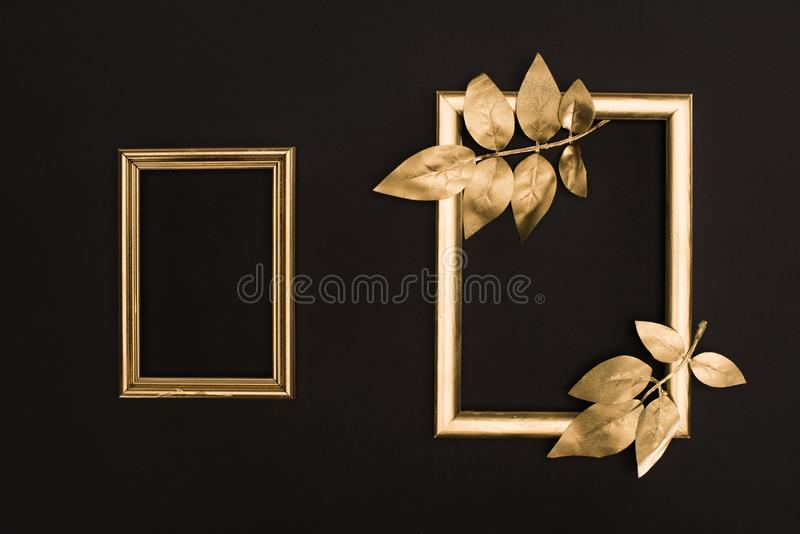 top view of golden photo frames and leaves stock photos