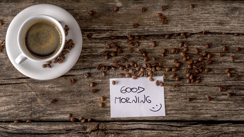 Top view of a Good morning message written on white card placed stock photos