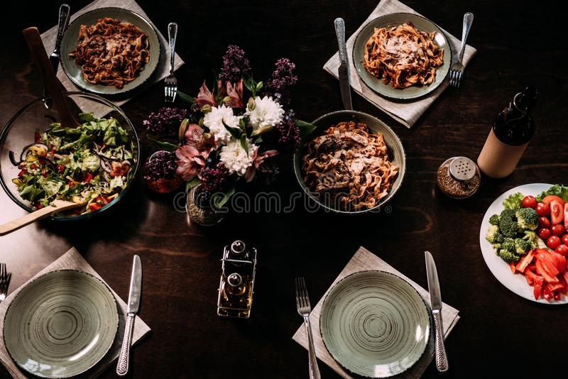 top view of gourmet dishes and cutlery on table served royalty free stock photography