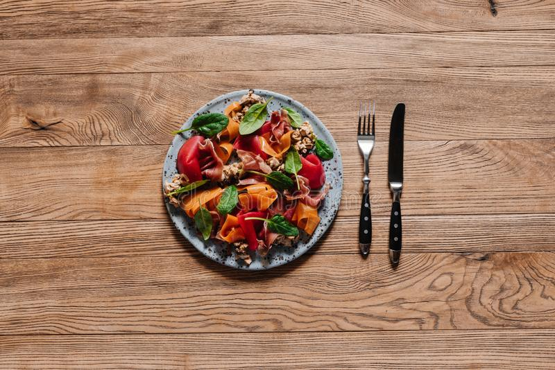 top view of gourmet salad with mussels, vegetables and jamon stock photos
