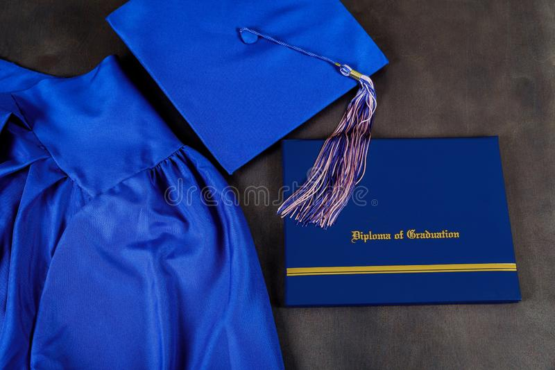 Top view of graduation mortarboard and certificate graduation on dark background, education concept. Top view of graduation cap, hat with degree paper royalty free stock images