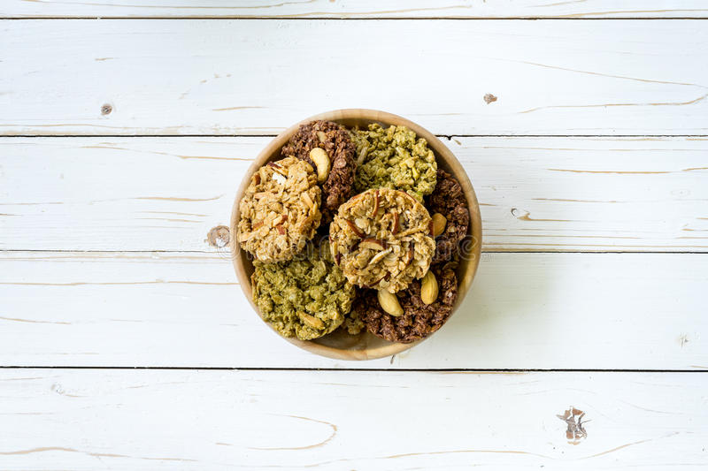 Top view granola bar in bowl on wood table background. royalty free stock photo