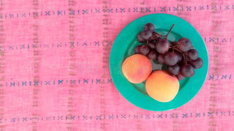 Top View of Grapes With Apricots in a Plate. Top View of Grapes With Apricots Served in a Plate royalty free stock photography