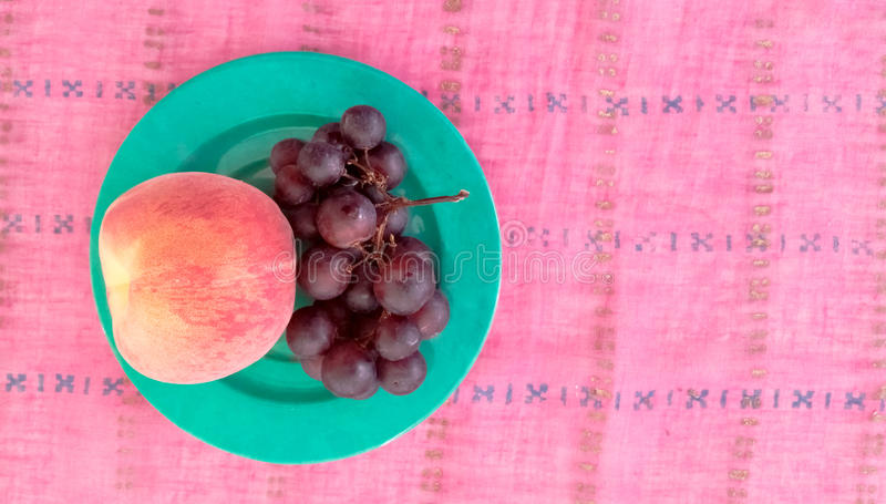 Top View of Grapes With Peach in a Plate. Top View of Grapes With Peach Served in a Plate stock images
