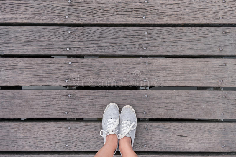Top view gray sneakers on bridge, Hipster style. Top view gray sneakers on wooden bridge, Hipster style royalty free stock image