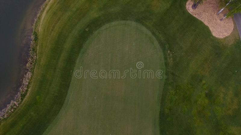 Top view green golf course outdoor green grass field. Aerial view from flying drone royalty free stock image