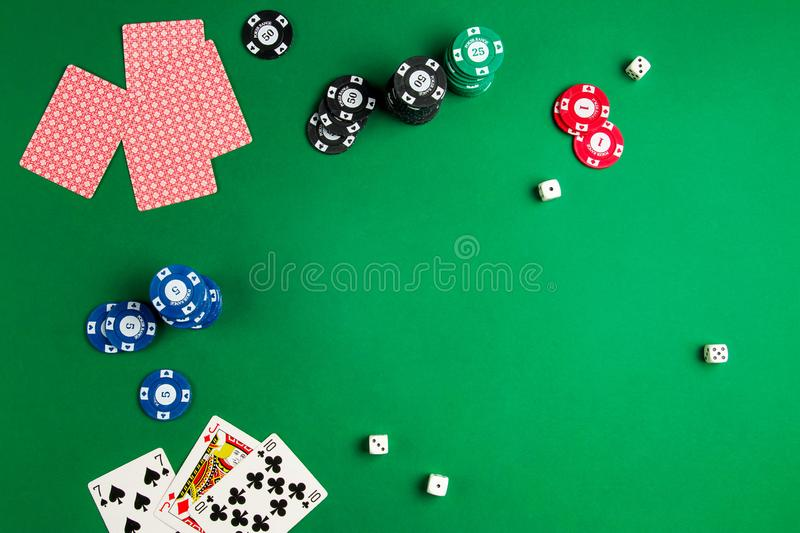 Top view of green poker game table with cards and chips stock photo