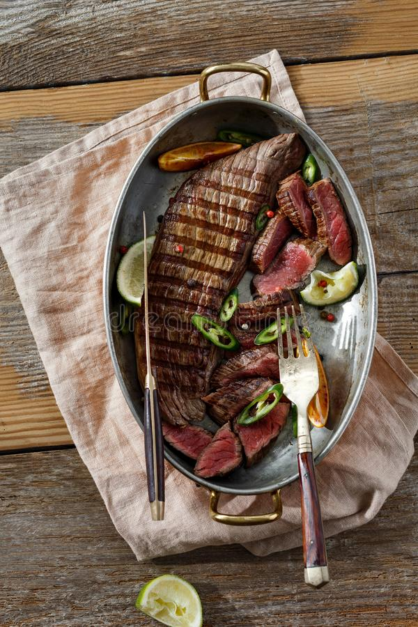 Top view grilled beef meat frying pan wooden table royalty free stock photos