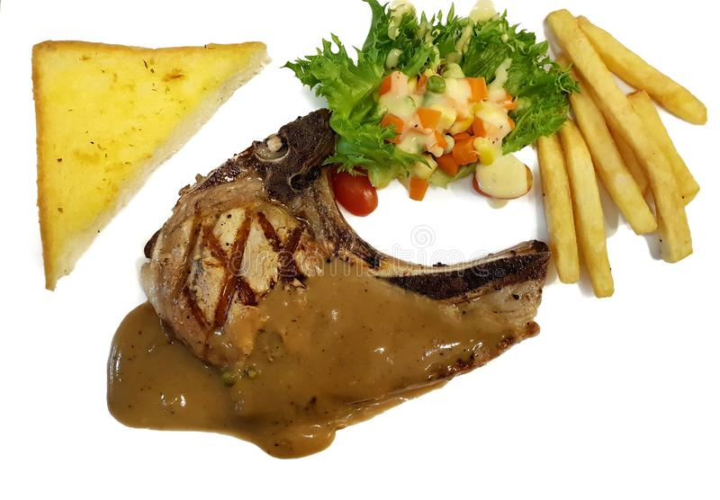 Top view of grilled Pork shop steak with french fries, garlic toast and salad vegetable. royalty free stock photography
