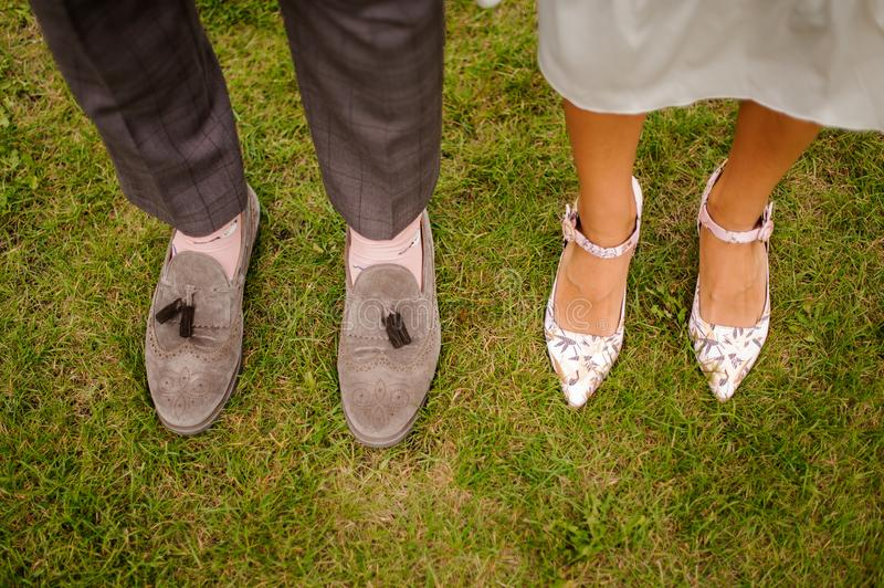 Top view of groom and bride legs royalty free stock images