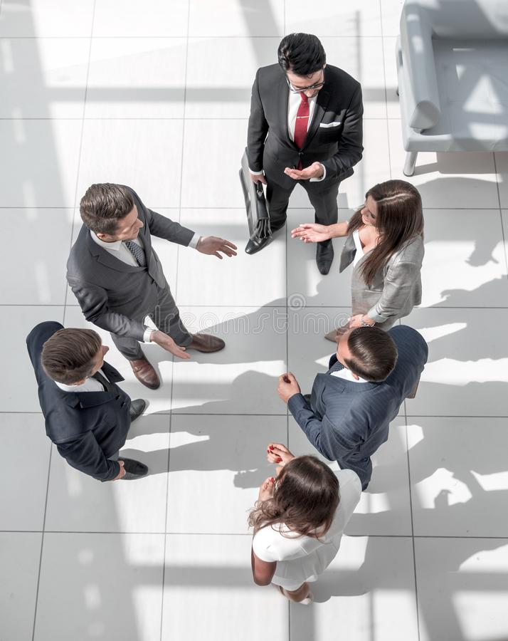 Top view.a group of business people talking standing in the hall royalty free stock photo