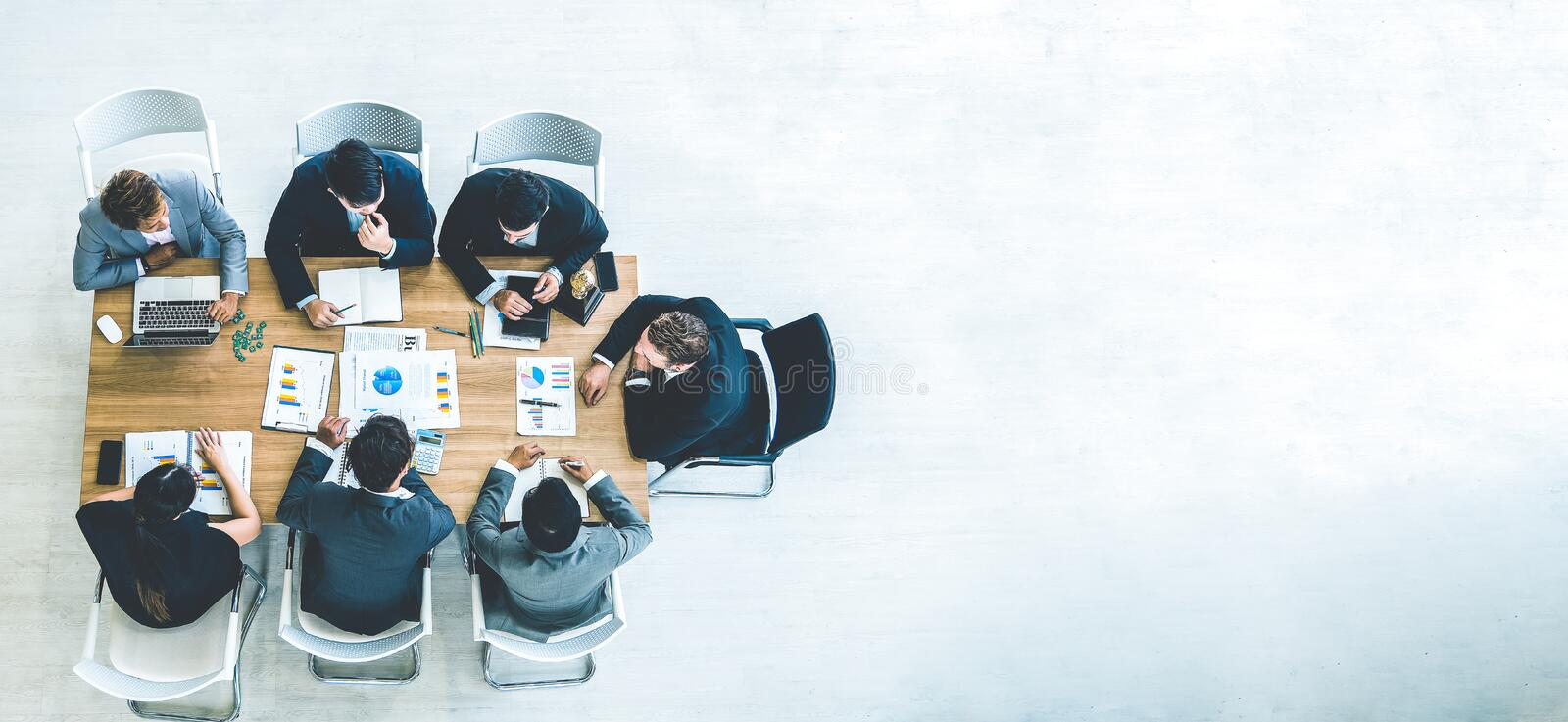 Top view on a group of businessman and businesswoman having a meeting and making a business commitment royalty free stock photos