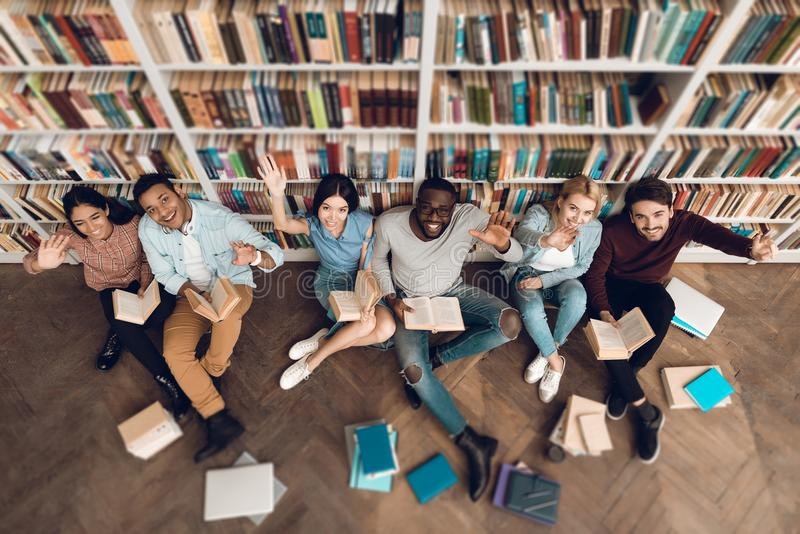 Top view group of ethnic multicultural students in library. stock images