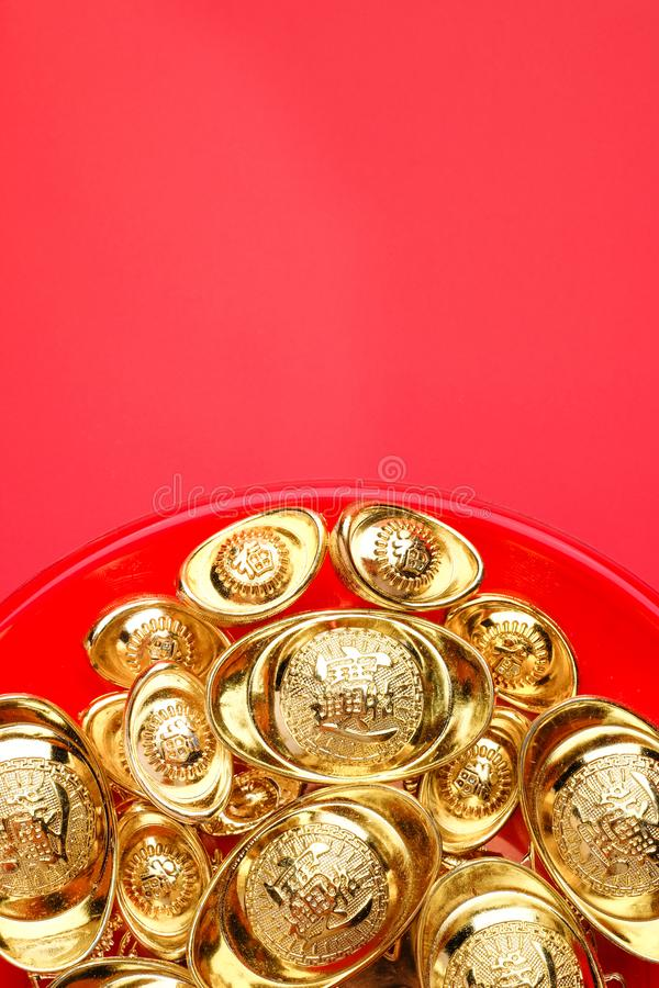 Top view group of golden ingots on red tray at red background.Chinese new year concept,leave space for adding stock photography