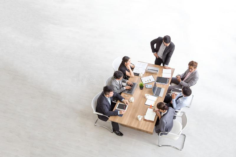 Top view of group of multiethnic busy people working in an office, Aerial view with businessman stock photo
