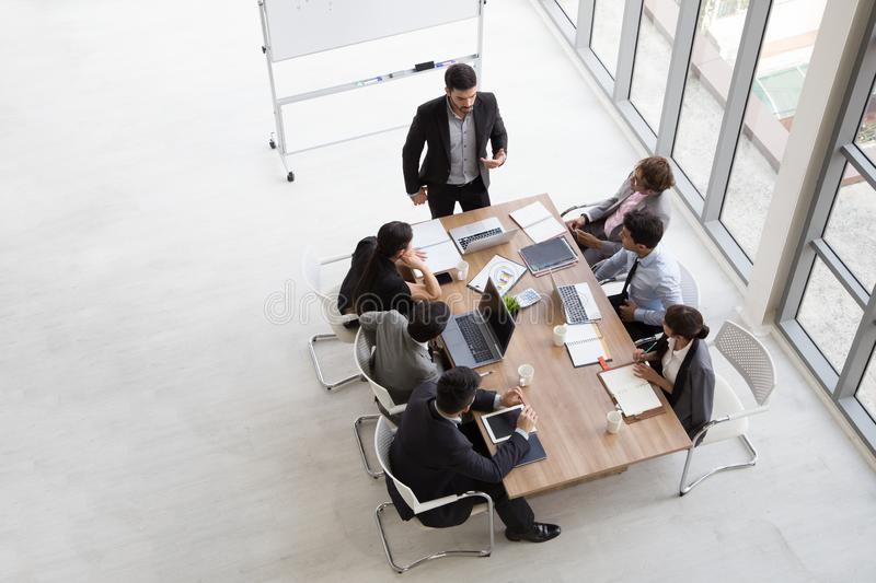 Top view of group of multiethnic busy people working in an office, royalty free stock image