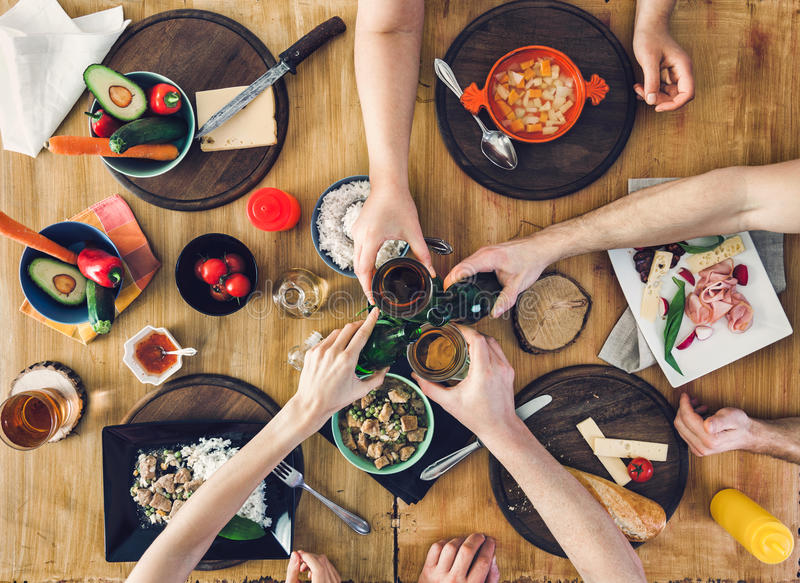 Top view, Group of people sitting at the table with food, enjoying a drink stock photos