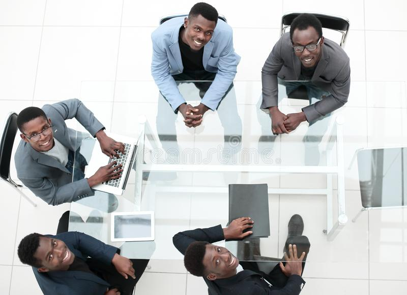 Top view. group of young business people at a meeting in the office royalty free stock image