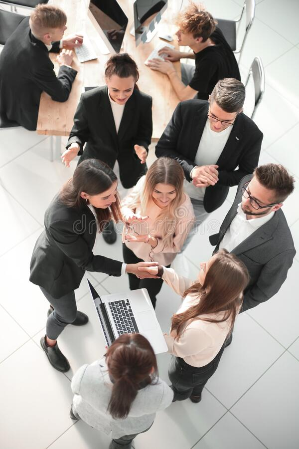 Top view. a group of young business people in a modern office. stock photography