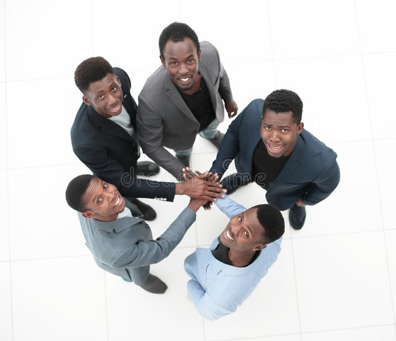 Top view . a group of young entrepreneurs showing their unity. Isolated on white stock image
